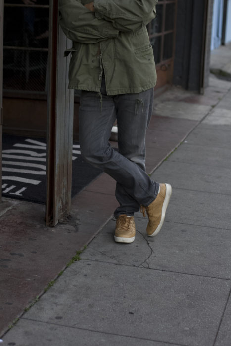 military jacket and tan sneakers
