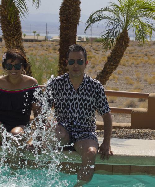 Travel blogger couple Rossana & Douglas poolside in Lake Havasu