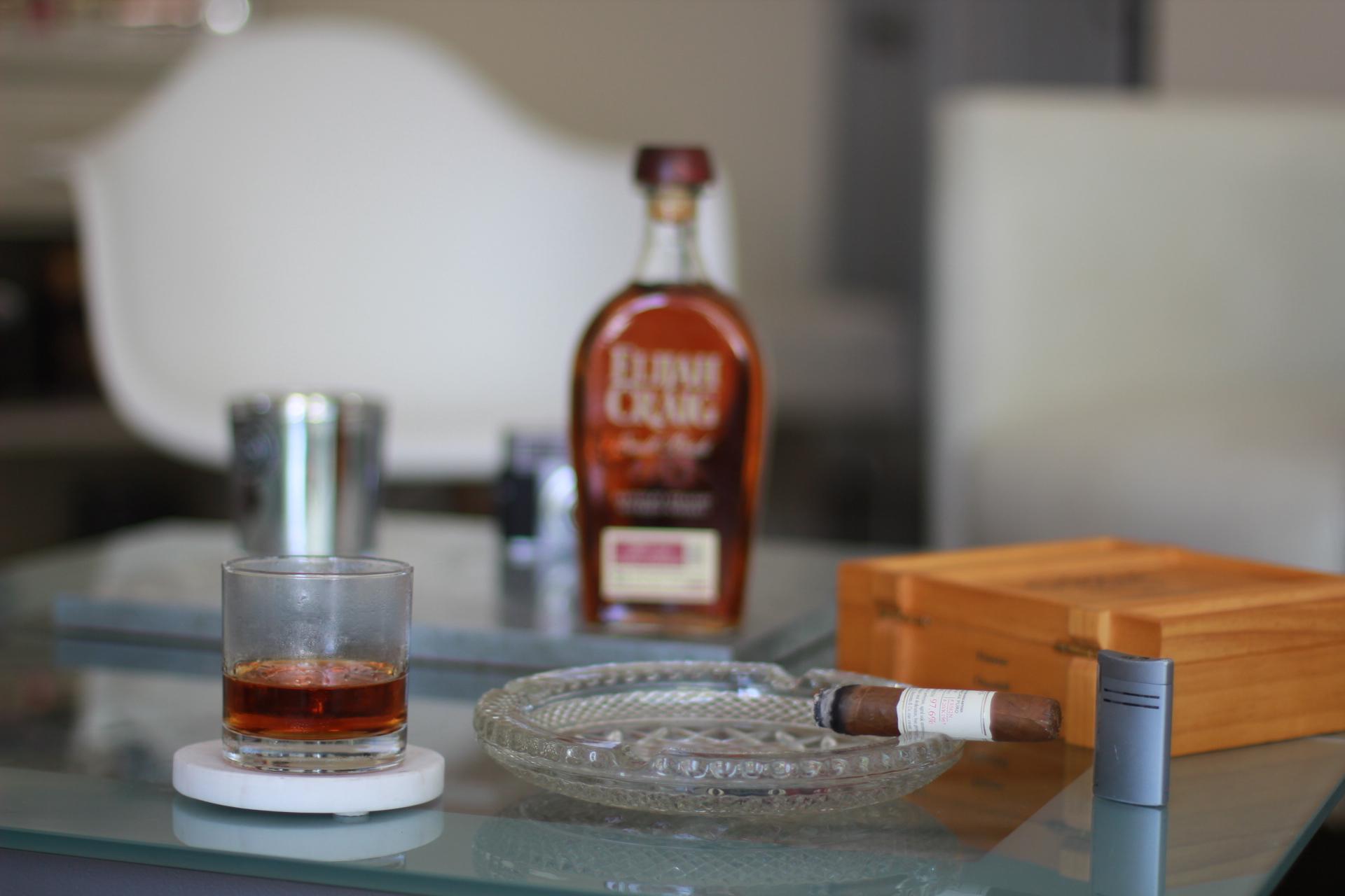 Enjoying a Gurkha cigar and whiskey